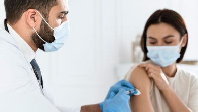 doctor vaccinating a young woman |